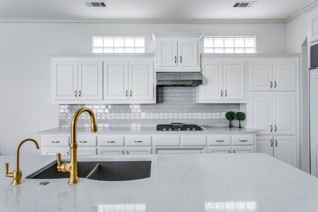 gold kitchen faucet highland park